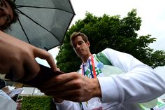 Andy Murray signs autographs on Day Six at Wimbledon