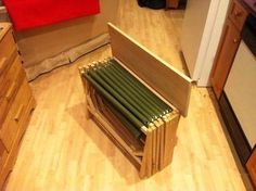 DIY build.  Accordion Folding bench seat. When it is closed, itmisma bench seat or turns into a table top. When fully opened and stretched out, an accordian folding cot. Very space saving in a small travel trailer or even for tent camping.    instructable bed2.jpeg