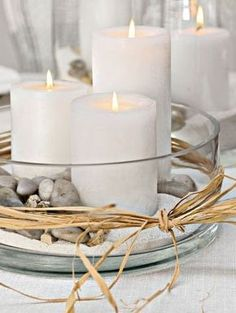 Perfect Centerpiece Via 15 Easy DIY Fall Centerpieces Some of the best candle arrangements incorporate nature. Make It Tall Via Beautiful flower arrangment Candels, Candle Lanterns, Pillar Candle Holders, Pillar Candles, White Candles, Candleholders, Diy Candles, Teal Candles, Sand Candles