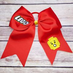This is a stiffened grosgrain cheer bow with embroidered design. Made of 3 ribbon and comes on ponytail elastic made by Yolis Bowtique in Miami. Most bows ship out in 2 business days. Please contact us if you have any questions. Girl Hair Bows, Girls Bows, Family Shirts, Shirts For Girls, Lego Shirts, Lego Birthday Party, 5th Birthday, Birthday Ideas, Custom Cheer Bows