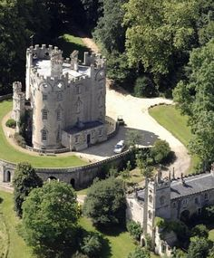 Midford Castle - a 'folly' castle built in 1775 in Bath, UK;  In architecture, a folly is a building constructed primarily for decoration, but suggesting by its appearance some other purpose, or merely extravagant, occasionally also used as a residence.
