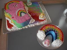"""Care Bears 1st Birthday - This was for a repeat customer, so I threw in the smash cake for free.  All marble cake with all buttercream icing.  I used Wilton Color Mist for the rainbow effect on the base cake (gosh, I wish I had an airbrush!).  I cut an 8"""" round for the smash cake rainbow.  The little care bears are plastic."""