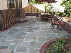 Bluestone patio with brick might then tie in to any brick or mixed materials used for pathways or terracota