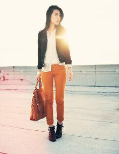 a cute way to wear orange jeans