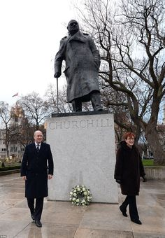 Family: Randolph Churchill and Celia Sandys, the great-grandson and granddaughter of former Prime Minister Sir Winston Churchill, laid a wreath at his statue on Parliament Square in London this morning - 30th January 2015