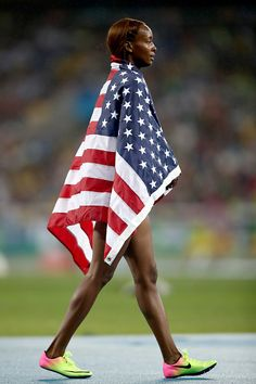Dalilah Muhammad of the United States celebrates winning gold in the Women's…
