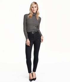 5-pocket pants in superstretch twill with slim legs and a high waist.