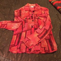 Silk Button Down by Chico's Beautiful tribal autumn colors in a sheer, 100% silk blouse from Chico's.  In excellent used condition. Chico's Tops Button Down Shirts