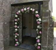 Wedding flower arch with white and pink Peonie flowers for wedding in Waterford Castle, Ireland