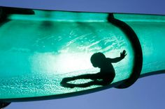A boy slides down a water chute in a public swimming pool in Thun, Switzerland.  Ruben Sprich is Reuters' chief photographer in Switzerland. He shoots everything from breaking and general news, to sports photography.