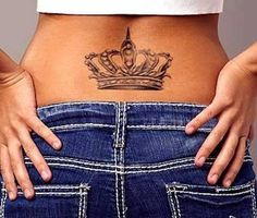 crown royal tramp stamp. Not my ideal spot but I love the tatt.
