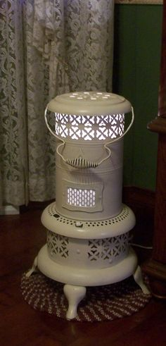 Kerosene heater painted & converted to lamp. I have one of these and can't decide: lamp, planter, or simply clean it up and allow it to be a kerosene heater? Repurposed Items, Repurposed Furniture, Diy Furniture, Modern Furniture, Furniture Design, Pinterest Decorating, Kerosene Heater, Kerosene Lamp, Diy Luminaire