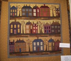 I am in love with this little house quilt.