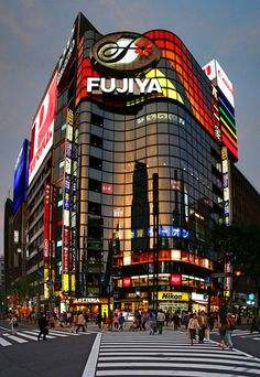 Ginza is Japan's largest luxury shopping district.   In the early 1990s, land here was (by far) the most expensive in the world.    Many of the world's top fashion and electronics brands have flagship stores here.      Ginza is known for its innovative architecture.