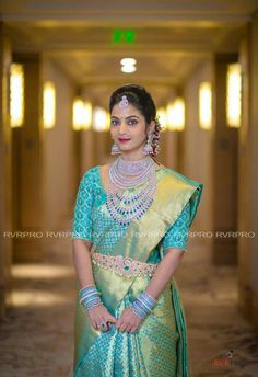 South Indian bride. Diamond Indian bridal jewelry.Jhumkis.Teal blue silk kanchipuram sari.Braid with fresh jasmine flowers. Tamil bride. Telugu bride. Kannada bride. Hindu bride. Malayalee bride.Kerala bride.South Indian wedding.