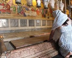women pray ,stone of anointing also call stone of unction Church of Holy Sepulchre Jerusalem