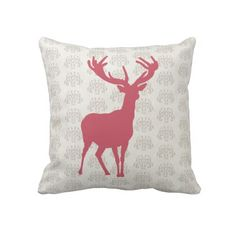 A fashionable design pink deer silhouette on a white damask style background on a quality throw pillow, a very modern look