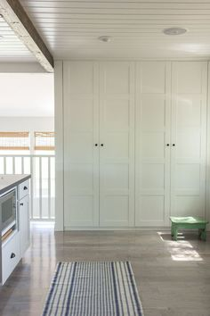 """Nothing says """"fancy"""" quite like a built-in pantry. TheseBergsbo-style IKEA cabinets provide hidden storage in a space that was otherwise a bare wall without a purpose. See more at Jenna Sue Design Co. »"""
