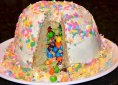 Candy Surprise Cake ---- M falling out of the cake....which kid would love this more?  W or E?