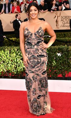 SAG Awards 2017 Best Dressed //GINA RODRIGUEZ   picks a slinky spaghetti-strap PatBo dress embroidered with birds and floral imagery, plus Hueb morganite earrings and rings by LFrank and Csarite.