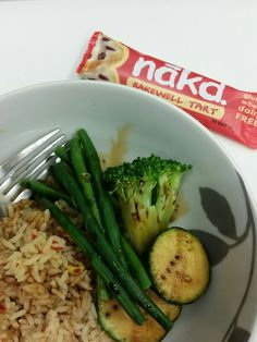 Healthy work lunch- vegetable rice, green beans courgette and broccoli, vegan friendly soy sauce, and a Nakd bar #vegan #veganlunch