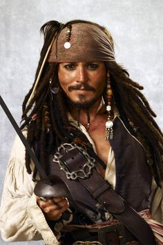 Disney 30 Day Challenge Day 13 Favorite Outfit - Jack Sparrow. This isn't an animated movie, but it is one of Disney's classics. The costumes in this franchise are award winning.
