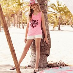 This candy pink summer outift is made complete by a pink slogan snap back hat, just perfect for a day at the beach.