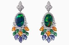 Étourdissant Cartier. Pushkar Earrings – white gold, two oval-shaped cabochon-cut black opals totaling 15.09 carats, carved mandarin garnets, carved tsavorite garnets, carved tanzanites, brilliant-cut diamonds.
