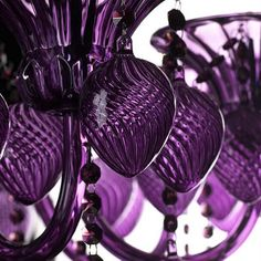 The purple version of the blue #chandelier hanging in our showroom!