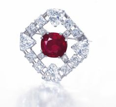A 10.10-carat Mogok Burmese Ruby and Diamond Brooch, Cartier - $8,428,127 in 2014 ($834,468 per carat) Set with a cushion-cut ruby  within an openwork octagonal plaque, set with square, rectangular, and triangular-shaped diamonds, platinum.
