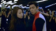 T.O.P and Sohee are a hot couple avoiding paparazzi in 'Reebok' CF   http://www.allkpop.com/article/2014/08/top-and-sohee-are-a-hot-couple-avoiding-paparazzi-in-reebok-cf