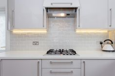 Recessed lighting under shlves. Also light from compact fume hood. Fume Hood, Gloss Kitchen, German Kitchen, Small Condo, Multifunctional Furniture, Compact Kitchen, Drop Leaf Table, Kitchen Images, Bespoke Kitchens