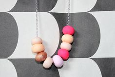 Big bead necklace with hot pink and copper accents.