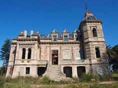 Ruined Mansion in Portugal. This elegant ruin was clearly the home of an affluent family before falling into dereliction. Several first floor windows have been sealed, suggesting an effort to protect the structure from vandals and the elements. But the gutted shell and open roof suggest a fire has since ripped through the building, making its future even more uncertain.