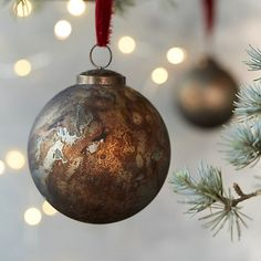 An antique patina tops this rustic globe for the holiday tree.- Glass, iron cap- Wipe clean with dry cloth- ImportedSmall: diameterLarge: Hobby Lobby Christmas Ornaments, Christmas Ornament Sets, Personalized Christmas Ornaments, Christmas Angels, Christmas Holidays, Christmas Bulbs, Christmas Decorations, Holiday Decorating, Anthropologie Christmas