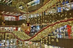 Christmas Decoration 2014: Multi-coloured Christmas trees and glittering blue snowflakes will line the shopping street from Tanglin Mall to Plaza Singapura. The many colours reflect Singapore's diversity as it celebrates 50 years of nationhood next year.
