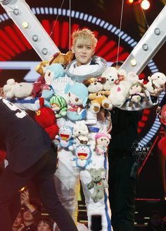 EXO tao surrounded by dolls costume