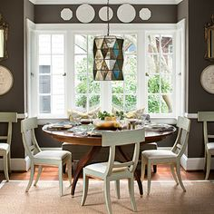 Painted dining room chairs with natural wood table.