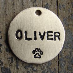 Stamped Dog Tag / Plain Pet Tag by TagMePetTags on Etsy https://www.etsy.com/listing/227050631/stamped-dog-tag-plain-pet-tag