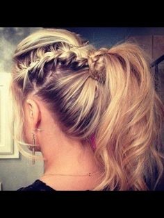 Small French Braid on the side, braid all the way down, secure with a clear elastic. Then tease the crown and put into ponytail. Wrap the remaining braid around hair tie.