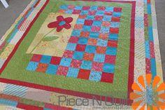 Piece N Quilt. Flower appliqué quilt