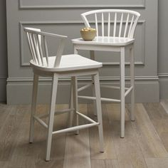 The iconic Windsor chair receives a modern makeover and gets raised up to counter or bar height, and with a rounded, low-profile back and clean, minimalist lines.