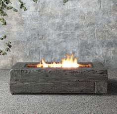 propane fire pit, cement that looks like woodgrain from Restoration Hardware - Driven by Decor