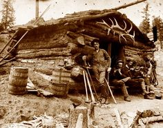 Roberts (probably the man standing) in Cripple Creek, Colorado. The others sit in the doorway stoop, one play Old West Photos, Antique Photos, Vintage Photographs, Vintage Photos, Cowboy Pictures, Hunting Pictures, Old Pictures, Old Western Towns, Western Art