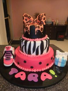3 tier birthday cake for girl with zebra stripes, Nike shoes, gift box and bow on top