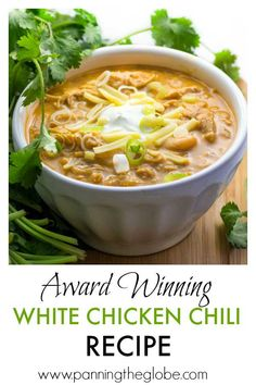 It's easy to cook a big pot of this award winning white chicken chili, and it's the absolute BEST! Tender chicken, chilies, white beans, spices and a few more goodies in this winning white chicken chili recipe! Top with sour cream, cheese, scallions, a drizzle of your favorite hot sauce. It's makes a lot of chili, but it freezes really well! #chicken #chili #recipe #ChickenChili Healthy White Chicken Chili, White Chicken Chile Recipe, Best Chicken Chili Recipe, Cream Cheese Chicken Chili, Crockpot Chicken Chili, Chicken Green Chili Soup, Low Carb Chili Recipe With Beans, Soupy Chili Recipe, White Chili Recipes