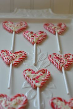 PLEASANT HOME: Quick and Easy Valentines Treats!  Like these.  Would need to be nut free candy canes and cannot use Wilton chocolate melts...just use bakers chocolate?