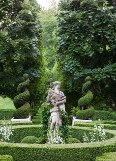 Garden Planning A photo of the statue and grove of trees in the Parterre Garden at Carolyne Roehm's Weatherstone - Beloved fashion icon Carolyne Roehm shares lessons learned in her venture to turn cornfields into a floral landscape.