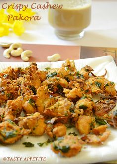 CRISPY CRUNCHY CASHEW PAKORA · Cashew nuts - 1 cup · Besan flour / kadalai maavu - 1 cup · Rice flour - ½ cup · Red chilly pwd - 1 ½ tsp · Ginger garlic paste - ½ tbsp · Chopped mint leaves - ½ cup · Finely chopped Onion - ½ cup - · Oil to deep fry · Salt to taste