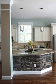 Kitchen Designs With Island From Stone. Like the pillar, the stone work and the lights.